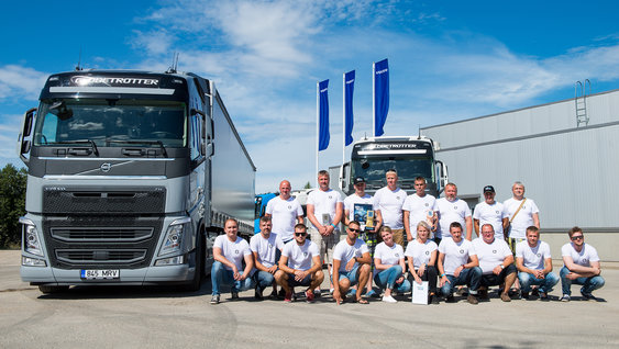 A group of people together with Volvo FH