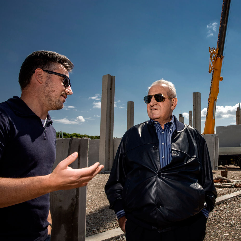Father Giorgio at the building site of the new Sartori headquarters.