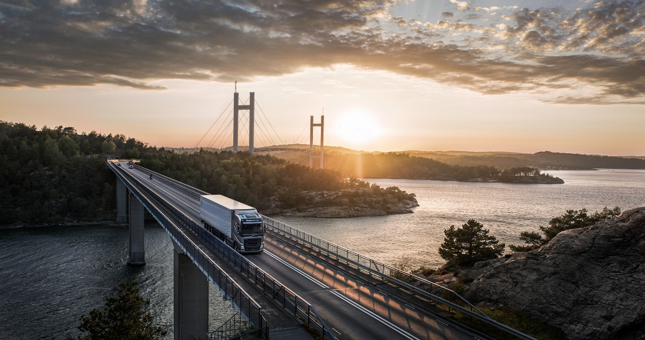 A connected Volvo Truck drives over a bridge in a remote location
